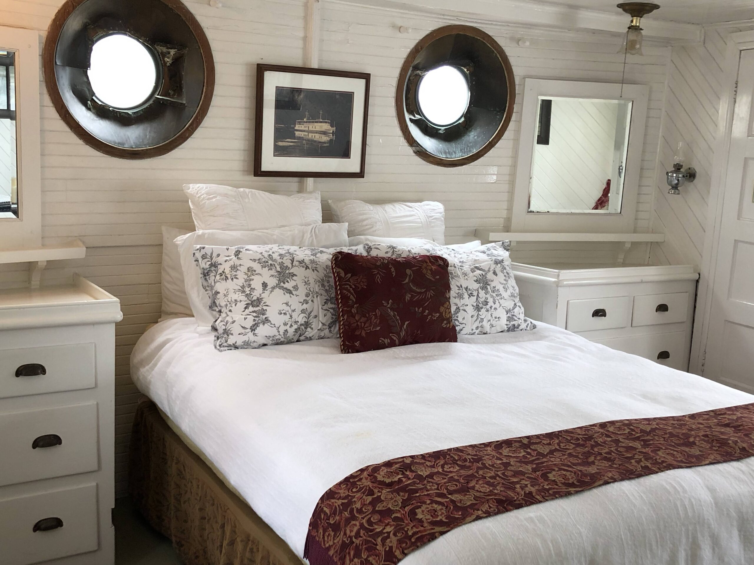 The bed and built-in drawers of the master stateroom on Lotus